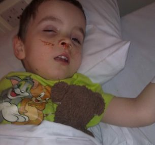 Harry asleep with teddy after being diagnosed