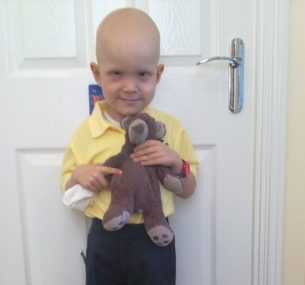 Harry on his First Day Of School in a yellow tshirt holding teddy 1