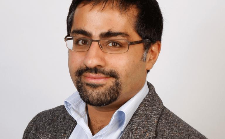 Sam Bejjati researcher wearing glassess min