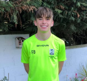 Felix in his lime green football kit 2021.