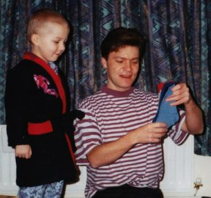 christopher with his dad looking a a pair of socks at christmas