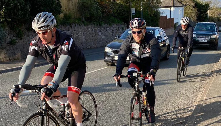 The Orchard brothers cycling uphill
