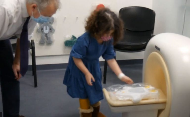 Child scanning a toy in model of the MRI scanner