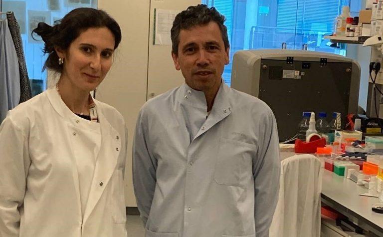 Tariq Enver and Elitza Deltcheva researchers wearing lab coats